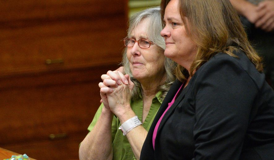 Susan Mellen, left, sits with her attorney Deirdre O'Connor, as she is exonerated of murder by Superior Court Judge Mark Arnold in Torrance, Calif., Friday, Oct. 10, 2014. Mellen spent 17 years in prison after being convicted of murder in the death of Richard Daly, a homeless man in 1997.  The judge said Mellen had inadequate representation by her attorney at trial.  The witness who claimed she heard Mellen confess, had a long history of giving false tips to law enforcement, according to documents in the case.   Three gang members subsequently were linked to the crime, and one was convicted of the killing.  (AP Photo/Daily Breeze, Brad Graverson, Pool )