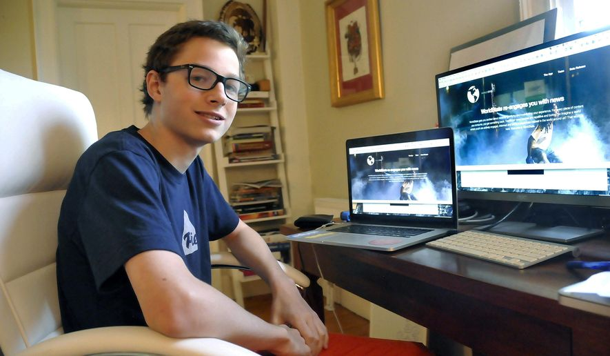 MEMBER FEATURE EXCHANGE ADVANCE FOR OCT. 12 -- In this Sept. 8, 2014 photo, Patrick Finnegan, 18, poses with his computers at home in Williamstown, Mass. Finnegan has not graduated high school yet -- he just hasn't had the time. He's been too busy building websites and launching two a start-up companies. (AP Photo/Berkshire Eagle, Scott Stafford)