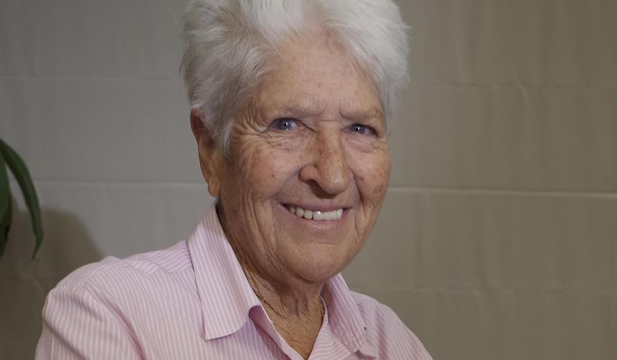 In this Thursday, Oct. 9, 2014 photo, Australian swimming great Dawn Fraser, who won the 100-meter freestyle gold medal in 1964 Summer Olympics in Tokyo, smiles during an interview with The Associated Press in Tokyo. While in Tokyo to celebrate the 50th anniversary of the 1964 Olympics, Fraser recalled how the first games in Asia helped her overcome a personal tragedy. She won the 100-meter freestyle at a third consecutive Olympics, but only after overcoming serious injury from a car crash which claimed the life of her mother that same year. Fraser spent nine weeks in a steel brace but recovered to swim an Olympic record in the final. (AP Photo/Haruka Nuga)