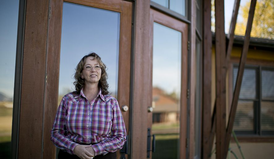 In this photo taken on Friday, Oct. 3, 2014, Ann Geiger, executive director and co-founder of Liberty Place, a non-profit organization that helps treat brain injury victims, looks out towards the Bootstrap Ranch outside Belgrade, Mont. Liberty Place recently purchased the 51-acre ranch, representing a large expansion for the 40 employee organization, with expected opening in Summer 2015. (AP Photo/Bozeman Daily Chronicle, Adrian Sanchez-Gonzalez)
