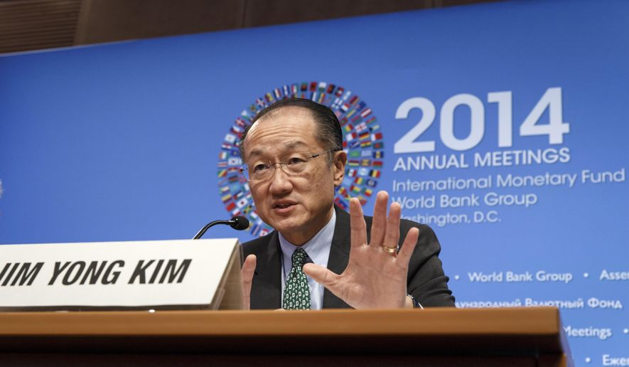 World Bank President Jim Yong Kim holds a news conference at International Monetary Fund (IMF) headquarters in Washington, Thursday, Oct. 9, 2014.   (AP Photo/J. Scott Applewhite)