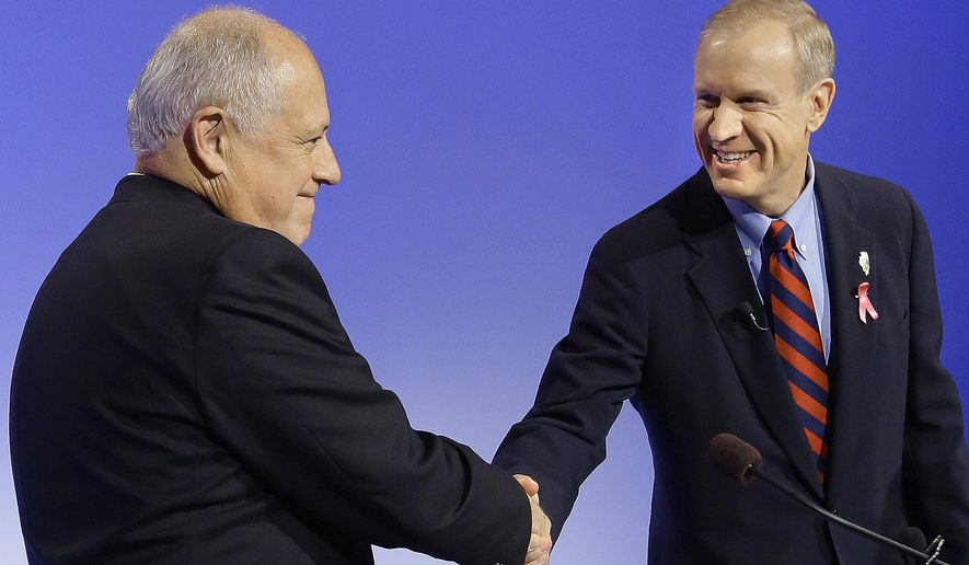 "In this Thursday, Oct.  9, 2014 photo, Democratic Illinois Gov. Pat Quinn, left, and Illinois Republican gubernatorial candidate Bruce Rauner shake hands during the first televised debate in Peoria Ill. Three major Illinois newspapers have endorsed Rauner over Quinn.  Quinn tells reporters he knows he won't win the ""newspaper endorsement battle"" and it's more important to get the voters' endorsement. (AP Photo/Seth Perlman)"