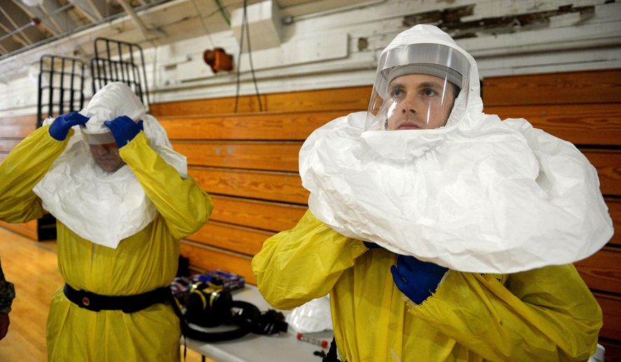 Members of the Army's 101st Airborne Division conduct a training exercise at Ft. Campbell, Ky., Thursday, Oct. 9, 2014. Members will travel to Liberia to build treatment centers and conduct medical training as part of the fight against the Ebola epidemic.  (AP Photo/The Courier-Journal, Stephen Lance Dennee) NO SALES; MAGS OUT; NO ARCHIVE; MANDATORY CREDIT