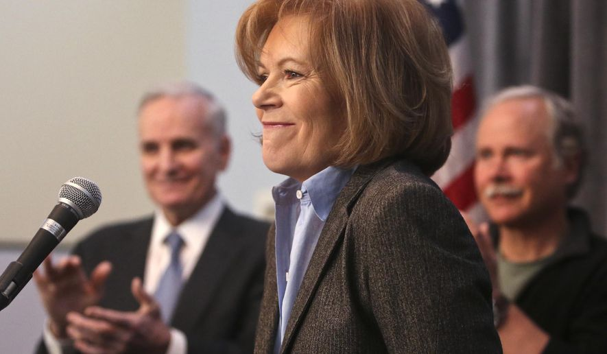 ADVANCE FOR SUNDAY, OCT. 12 - FILE - In this Feb. 4, 2014 file photo Tina Smith is applauded by Gov. Mark Dayton, left, and her husband Archie, right, as she is introduced as Dayton's running mate for his second term.  If voters grant Dayton four more years, he said they can expect he'll stick around for all of them despite rumors he's heard that he would leave office sooner and catapult running Smith into the top job. (AP Photo/The Star Tribune, David Joles, File)  MANDATORY CREDIT; ST. PAUL PIONEER PRESS OUT; MAGS OUT; TWIN CITIES TV OUT