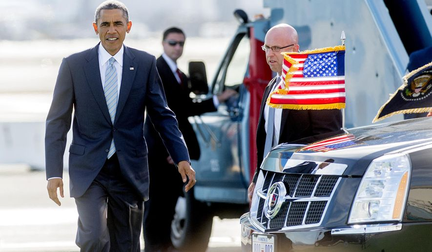 President Barack Obama arrives at San Francisco International Airport on Friday, Oct. 10, 2014, in San Francisco. Obama is scheduled to attend two fundraising events before departing Saturday. (AP Photo/Noah Berger)