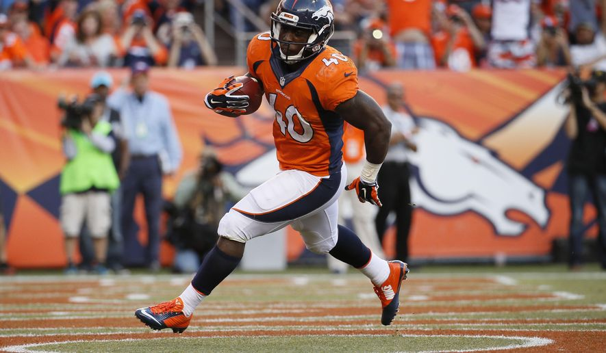 Denver Broncos running back Juwan Thompson (40) scores against the Arizona Cardinals during the second half of an NFL football game, Sunday, Oct. 5, 2014, in Denver. (AP Photo/Jack Dempsey)