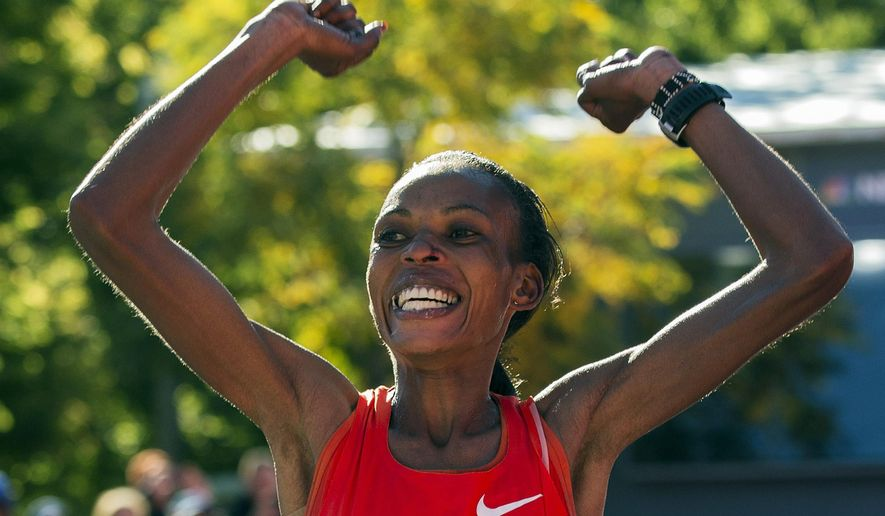 FILE - In this Oct. 13, 2013, file photo, Rita Jeptoo of Kenya wins the women's division of the Chicago Marathon in Chicago. The 2014 Chicago Marathon is Sunday, Oct. 12(AP Photo/Andrew A. Nelles, File)