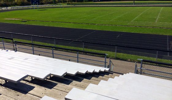 In this Thursday, Oct. 9, 2014 photo released by WEYI-TV, the Caro High School football field is seen from the stands in Caro, Mich. Caro High School has canceled the remainder of its season with just three games left to play, WEYI-TV reported. The team collectively made the decision with the support of two-thirds of its players. (AP Photo/WEYI-TV, Stephanie Parkinson) LOCAL TV OUT; MANDATORY CREDIT.
