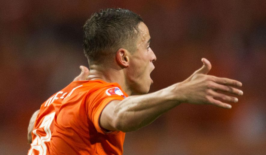Netherlands' Ibrahim Affelay celebrates scoring 2-1 during the Euro 2016 qualifying match between The Netherlands and Kazakhstan at ArenA stadium in Amsterdam, Netherlands, Friday, Oct. 10, 2014. (AP Photo/Peter Dejong)