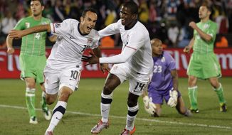 In this June 23, 2010, file photo, United States' Landon Donovan, foreground left, celebrates after scoring a goal with fellow team member United States' Edson Buddle, foreground right, as Algeria goalkeeper Rais M'Bolhi, second from left in background, reacts during the World Cup group C soccer match between the United States and Algeria at the Loftus Versfeld Stadium in Pretoria, South Africa. In a matchup of teams from this year's World Cup, the U.S. plays Ecuador, Friday, Oct. 10, 2014, in an exhibition that marks Landon Donovan's finale with the American national team. (AP Photo/Elise Amendola, File)