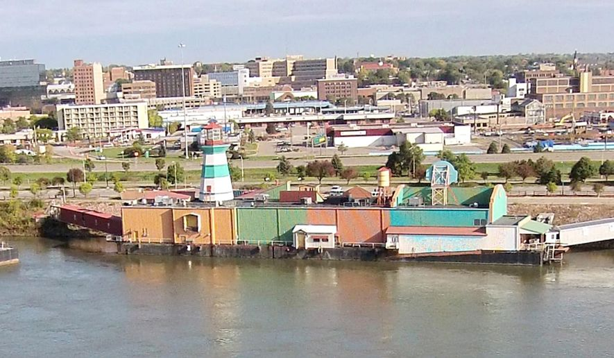 In this photo taken on Thursday, Oct. 9, 2014, work continues to dismantle the structures that housed offices of the former Argosy riverboat casino in Sioux City, Iowa. Now that the former Argosy riverboat casino is being removed, Sioux City officials are beginning to consider options for the soon-to-be vacant riverfront space. (AP Photo/The Sioux City Journal, Jim Lee)   NO SALES, MAGS OUT, TV OUT, MANDATORY CREDIT