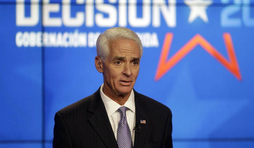 Democrat Charlie Crist, a former Republican governor of Florida, responds to a question during a gubernatorial debate against Florida Republican Gov. Rick Scott at the Spanish-language network Telemundo 51, Friday, Oct. 10, 2014, in Miramar, Fla.This is the first of three debates before the November election. (AP Photo/Lynne Sladky)