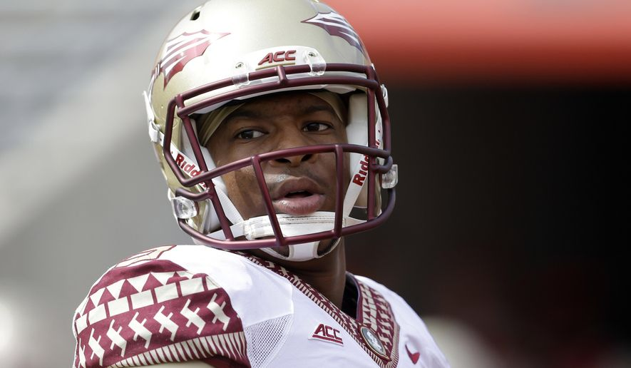 FILE - In this Sept. 27, 2014, file photo, Florida State's quarterback Jameis Winston warms up prior to an NCAA college football game against North Carolina State in Raleigh, N.C. Florida State University released a document Friday morning, Oct. 10, 2014,  defending itself in the handling of the sexual assault investigation of quarterback Jameis Winston, detailing its own timeline of events.  (AP Photo/Gerry Broome, File)