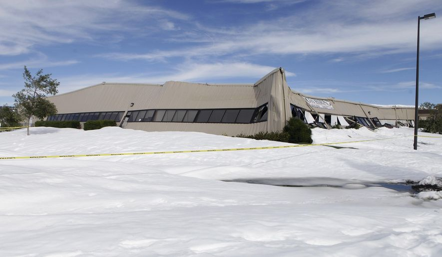 This Oct. 7, 2013, file photo shows the TMone call center building in Spearfish, S.D., which collapsed from the weight of snow from an early season blizzard. City leaders in Spearfish have approved building a $5.8 million facility to replace a city-owned call center that collapsed during a blizzard a year ago. (AP Photo/Rapid City Journal, Kristina Barker, File)