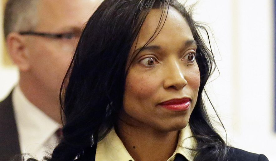FILE - In this Jan. 17, 2014 file photo shows Judge Tracie Hunter entering the Hamilton County Common Pleas Court for her arraignment in Cincinnati. Jurors are in their third day of trying to reach a verdict on felony charges that face Hunter, a juvenile court judge in southwest Ohio. The Hamilton County Common Pleas jury resumed Friday, Oct, 10, 2014. (AP Photo/Al Behrman, File)