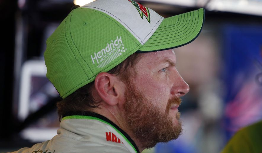 Dale Earnhardt Jr. looks out of the garage during practice for Saturday's NASCAR Bank of America Sprint Cup series auto race at Charlotte Motor Speedway in Concord, N.C., Friday, Oct. 10, 2014. (AP Photo/Chris Keane)