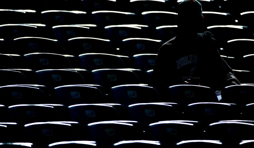A Philadelphia Eagles fan sits in the stands at Lincoln Financial Field before an NFL football game against the St. Louis Rams, Sunday, Oct. 5, 2014, in Philadelphia. (AP Photo/Matt Rourke)