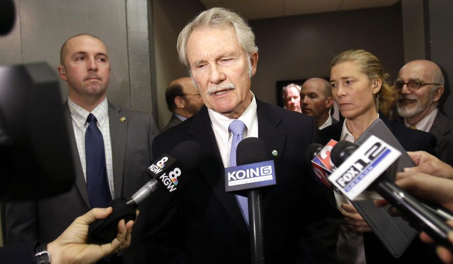 Oregon Democratic Gov. John Kitzhaber makes a statement before his gubernatorial debate with Republican challenger Dennis Richardson in Portland, Ore., Friday, Oct. 10, 2014. This is Kitzhaber's first public appearance since Thursday's admission by his fiance, Cylvia Hayes, to violating the law in 1997 when she married an immigrant seeking to retain residency in the United States. (AP Photo/Don Ryan)