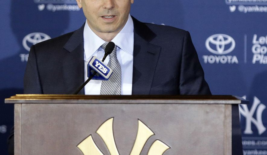 FILE - In this Feb. 11, 2014, file photo, New York Yankees general manager Brian Cashman speaks during a news conference at Yankee Stadium in New York. The Yankees announced Friday, Oct. 10, 2014, that they have re-signed Cashman to a three-year contract. (AP Photo/Frank Franklin II, File)