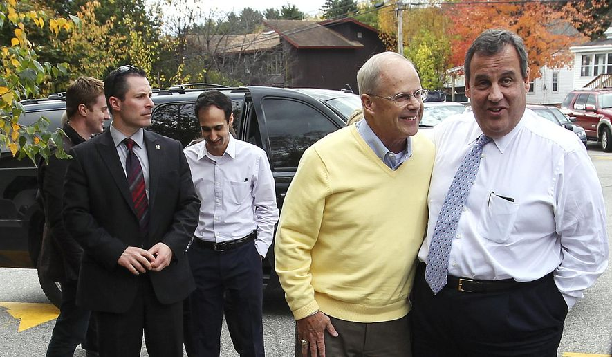 New Jersey Gov. Chris Christie, right, campaigns with Republican gubernatorial candidate Walt Havenstein, second from right, at a dairy bar in Berlin, NH,  Friday, Oct. 10, 2014.  Christie, visiting New Hampshire for the fourth time, said the race is winnable for Havenstein, despite a recent University of New Hampshire poll that shows him trailing Democratic Gov. Maggie Hassan by 10 points. (AP Photo/Cheryl Senter)