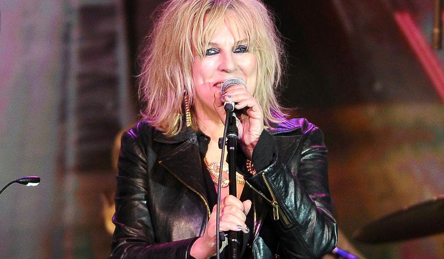 """FILE - In this April 23, 2014 file photo, Lucinda Williams performs on stage at the 31st Annual ASCAP Pop Music Awards in Los Angeles. Williams released a new album, """"Down Where the Spirit Meets the Bone,"""" with 20 songs on two CDs. (Photo by Chris Pizzello/Invision/AP, File)"""
