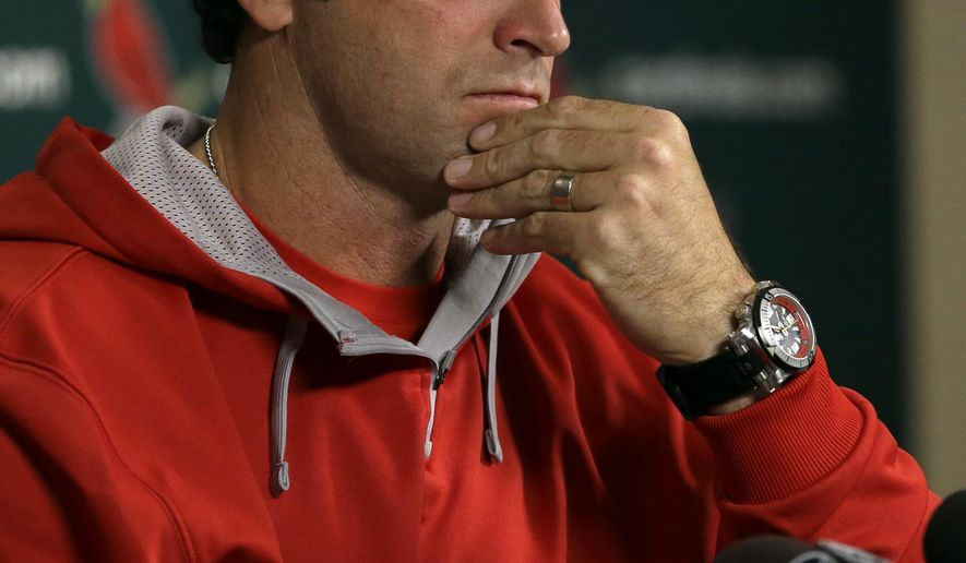 St. Louis Cardinals manager Mike Matheny listens to a question during a news conference Thursday, Oct. 9, 2014, in St. Louis. The St. Louis Cardinals and San Francisco Giants are scheduled to play Game 1 of baseball's National League Championship Series on Saturday in St. Louis. (AP Photo/Jeff Roberson)