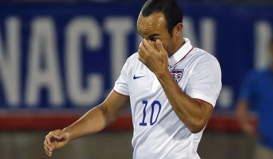 United State's Landon Donovan wipes his eye as he comes out of an exhibition soccer match against Ecuador in East Hartford, Conn., Friday, Oct. 10, 2014. Donovan is making his last international soccer appearance. (AP Photo/Elise Amendola)