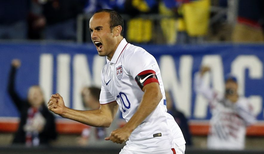 United States' Landon Donovan celebrates his teammate Mix Diskerud's goal in the first half of an exhibition soccer match against Ecuador in East Hartford, Conn., Friday, Oct. 10, 2014. Donovan was making his last international soccer appearance. (AP Photo/Elise Amendola)