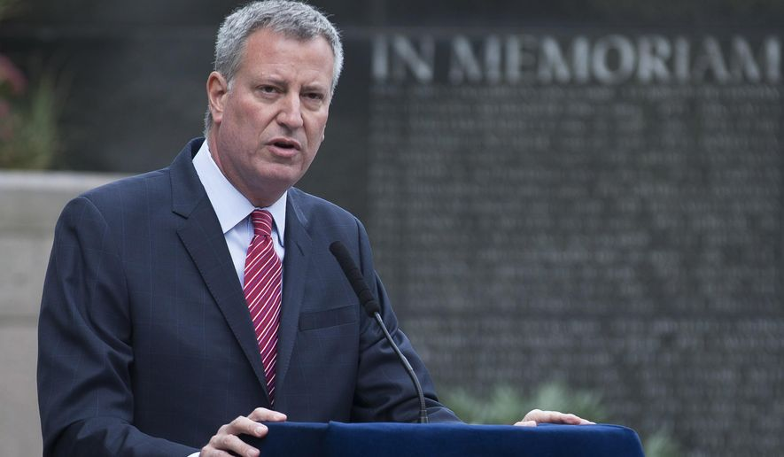Mayor Bill de Blasio speaks at an NYPD Memorial ceremony on Friday, Oct. 10, 2014 in New York.  De Blasio's relationship with the NYPD comes under further scrutiny after more damaging revelations have come to light about top aide Rachel Noerdlinger. (AP Photo/John Minchillo)