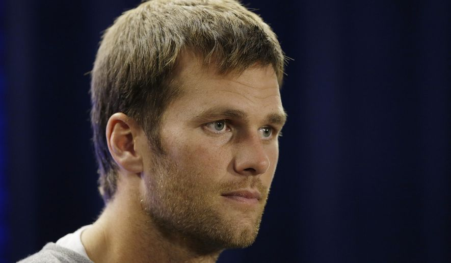 New England Patriots quarterback Tom Brady listens to a reporter's question during a media availability at the NFL football team's facility Wednesday, Oct. 8, 2014 in Foxborough, Mass. The Patriots play the Buffalo Bills in Buffalo on Sunday. (AP Photo/Stephan Savoia)