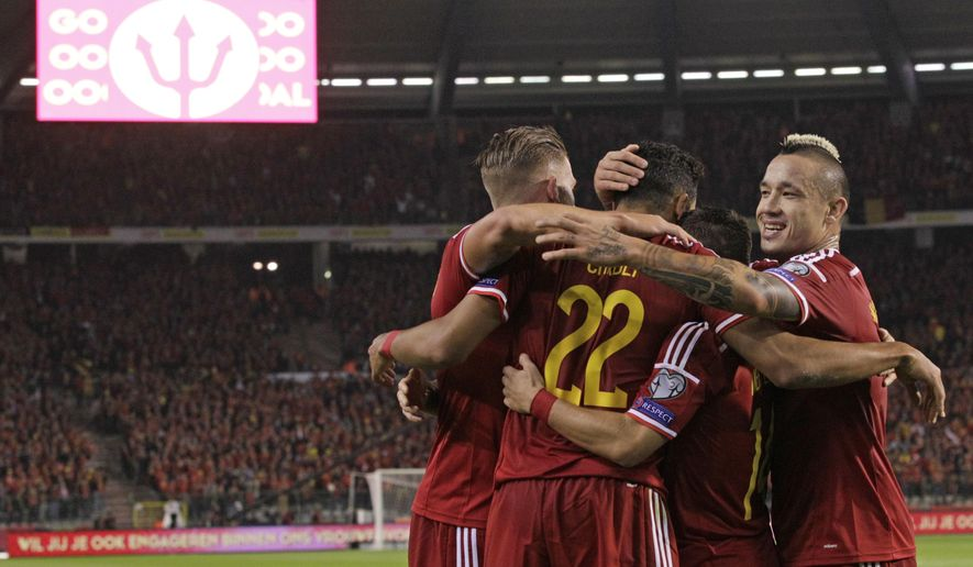 Belgium's Nacer Chadli, center, gets congratulations from his team after he scored, during the Euro 2016 qualifying match in group B, between Belgium and Andorra, at the King Baudouin stadium, in Brussels, Friday, Sept. 10, 2014. (AP Photo/Yves Logghe)