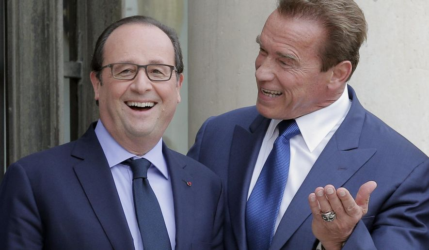 Former Governor of California and founding chair of the R20 initiative, Arnold Schwarzenegger, right, jokes with French President Francois Hollande prior to a meeting at the Elysee Palace in Paris, Friday, Oct. 10, 2014. (Associated Press) ** FILE **