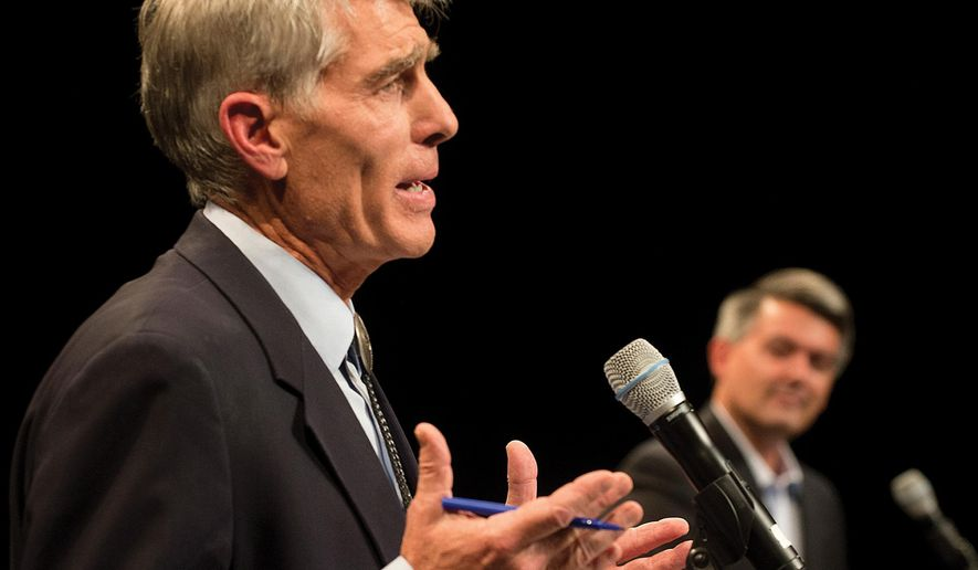 Democrat Mark Udall, left, makes a point as Republican opponent Corey Gardner listens during their debate for the Colorado U.S. Senate at Memorial Hall on Thursday, Oct. 9, 2014 in Pueblo, Colo. (AP Photo, Chris McLean/The Pueblo Chieftain)