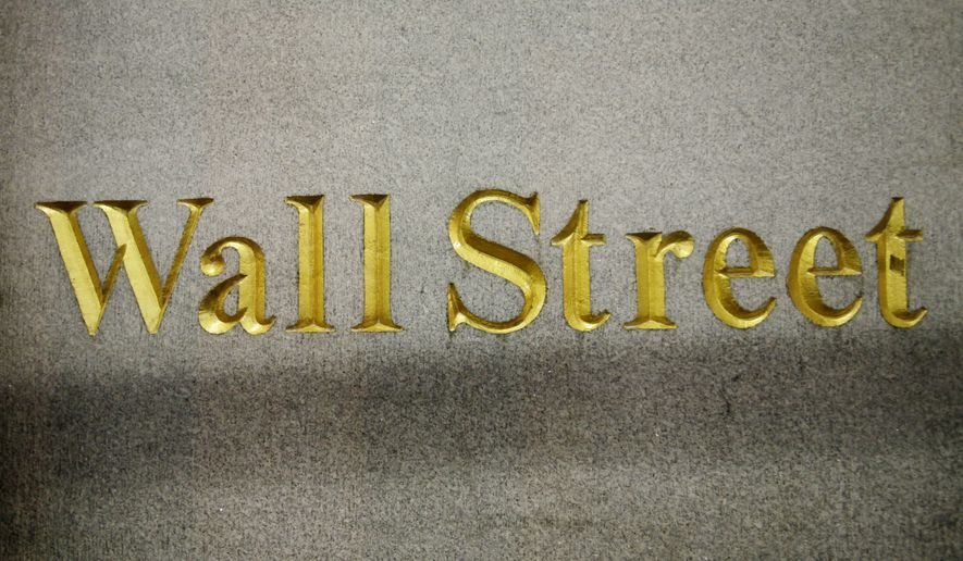 A Wall Street address is carved in the side of a building, Wednesday, Oct. 8, 2014 in New York. Global stocks sank Friday Oct. 10, 2014 after Wall Street suffered its worst day of the year and weak German trade data fueled worry Europe is sliding into recession. (AP Photo/Mark Lennihan)
