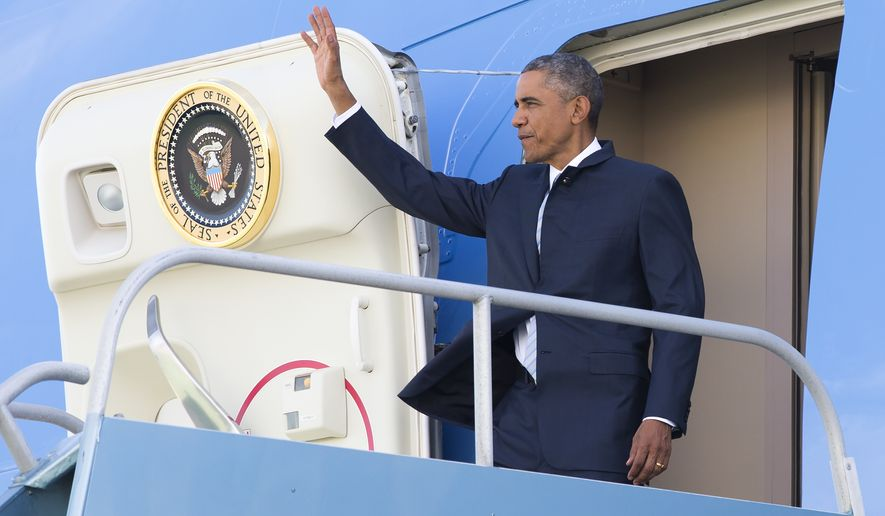 President Barack Obama waves as he steps off Air Force One after arriving at San Francisco International airport, on Friday, Oct. 10, 2014, in San Francisco. Obama is visiting San Francisco for fundraiser events. (AP Photo/Evan Vucci)