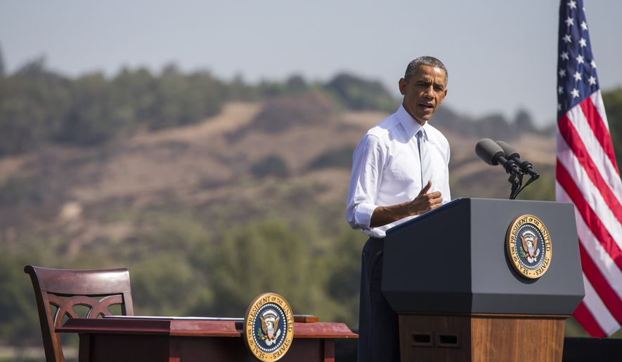 President Barack Obama speaks at Frank G. Bonelli Regional Park  in San Dimas, Calif.,  Friday, Oct. 10, 2014. Obama designated the nearly 350,000 acres within the San Gabriel Mountains northeast of Los Angeles a national monument. Supporters say the move will provide recreational opportunities for millions of people _ minorities and children in particular _ who live in Los Angeles County, one of the most disadvantaged areas in terms of access to open space. Local officials worry about potential use restrictions (AP Photo/Evan Vucci)
