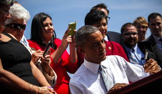 President Barack Obama is joined on stage by local supporters as he signs an executive order designating the San Gabriel Mountains National Monument, at Frank G. Bonelli Regional Park in San Dimas, Calif., Friday,  Oct. 10, 2014.  (AP Photo/Los Angeles Times, Jay L. Clendenin)