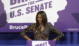 First Lady of the United States Michelle Obama speaks to the crowd at the Iowa Votes Rally on Friday, Oct. 10, 2014 at the Drake Fieldhouse in Des Moines. Obama was there to stump for U.S. Senate candidate Bruce Braley. (AP Photo/The Des Moines Register, Kelsey Kremer)