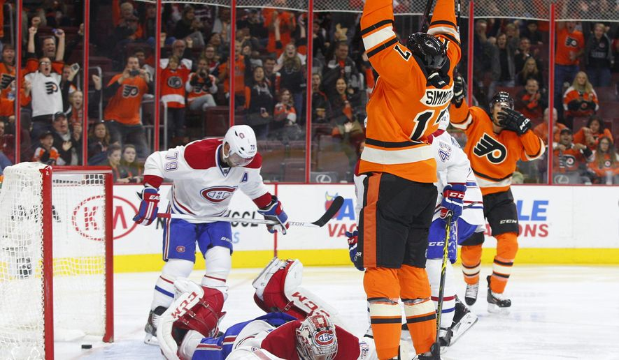 Philadelphia Flyers' Wayne Simmonds, front right, celebrates his second goal against Montreal Canadiens' Carey Price, center, as Canadiens' Andrei Markov, left, of Russia, reacts during the second period of an NHL hockey game, Saturday, Oct. 11, 2014, in Philadelphia. (AP Photo/Chris Szagola)