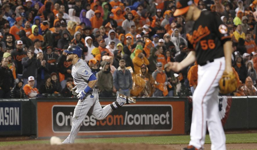 Kansas City Royals' Alex Gordon (4) runs after hitting a solo home run off Baltimore Orioles relief pitcher Darren O'Day (56) during the 10th inning of Game 1 of the American League baseball championship series Saturday, Oct. 11, 2014, in Baltimore. (AP Photo/Alex Brandon)