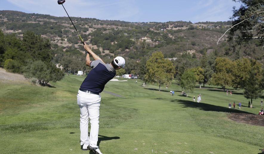 Bae Sang-moon of South Korea follows his drive from the fourth tee of the Silverado Resort North Course during the third round of the Frys.com PGA Tour golf tournament Saturday, Oct. 11, 2014, in Napa, Calif. (AP Photo/Eric Risberg)