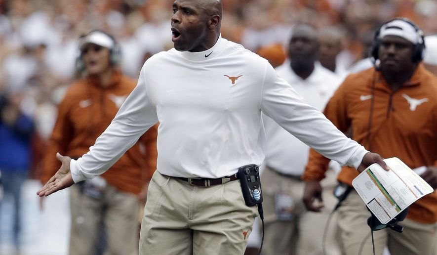 Texas head coach Charlie Strong argues a call during the first half of an NCAA college football game against Oklahoma at the Cotton Bowl, Saturday, Oct. 11, 2014, in Dallas. (AP Photo/LM Otero)