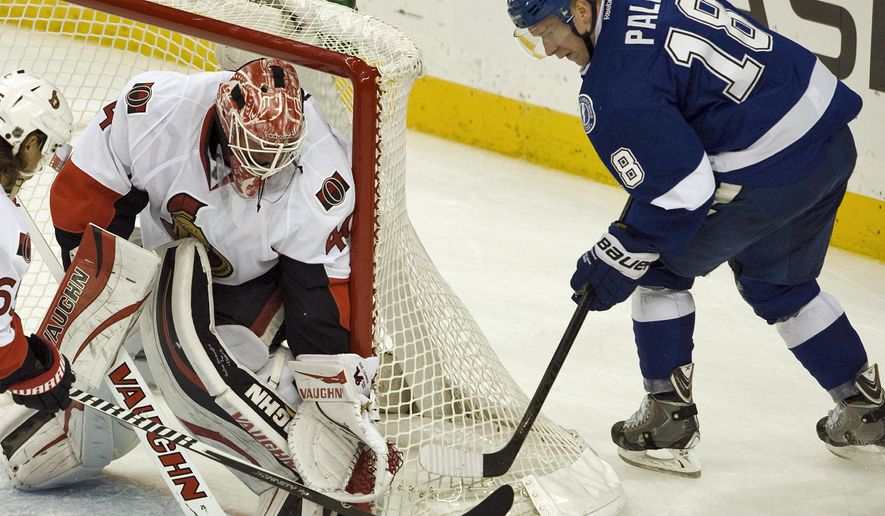 Ottawa Senators goalie Robin Lehner, left, stops a shot from Tampa Bay Lightning center Ondrej Palat (18) during the second period of an NHL hockey game Saturday, Oct. 11, 2014 in Tampa, Fla. (AP Photo/Steve Nesius)