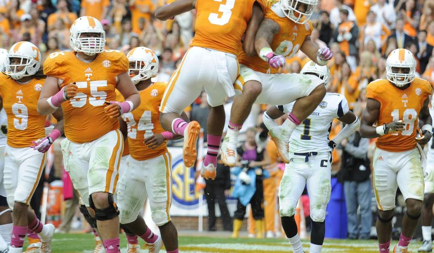 Tennessee wide receivers Josh Malone (3) and Johnathon Johnson (81) celebration after Johnson's touchdown against Chattanooga during an NCAA college football game in Knoxville, Tenn., Saturday, Oct. 11, 2014.  Tennessee won 45-10.  (AP Photo/Knoxville News Sentinel, Adam Lau)
