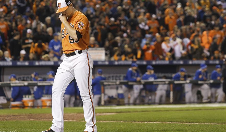 Baltimore Orioles relief pitcher Zach Britton walks to the dugout following the third out in the ninth inning of Game 2 of the American League baseball championship series against the Kansas City Royals Saturday, Oct. 11, 2014, in Baltimore. (AP Photo/Patrick Semansky)