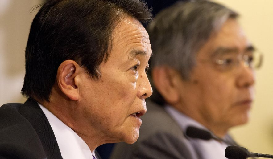 Taro Aso, Deputy Prime Minister of Japan and Minister of Finance, left, and Haruhiko Kuroda, Minister of State for Financial Services and Governor of the Bank of Japan, speak to the media at the International Monetary Fund and World Bank meetings in Washington, Friday, Oct. 10, 2014. Finance ministers from the world's largest economies said Friday they are determined to prevent a slide into another global recession, but a top U.S. official expressed frustration that a number of major economies were not doing enough to bolster growth. (AP Photo/Jacquelyn Martin) (AP Photo/Jacquelyn Martin)