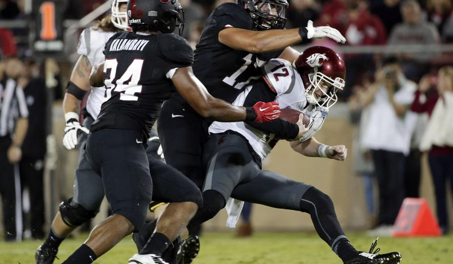 Washington State quarterback Connor Halliday, right, is sacked by Stanford linebacker A.J. Tarpley, center, during the second half of an NCAA college football game on Friday, Oct. 10, 2014, in Stanford, Calif. Stanford won 34-17. (AP Photo/Marcio Jose Sanchez)