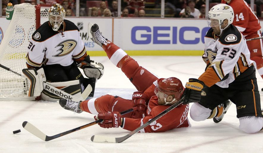 Detroit Red Wings' Johan Franzen (93), of Sweden, tries to get a shot off against Anaheim Ducks' Frederik Andersen (31), of Denmark after being knocked down by Anaheim Ducks' Francois Beauchemin (23) during the second period of an NHL hockey games Saturday, Oct. 11, 2014, in Detroit. (AP Photo/Duane Burleson)