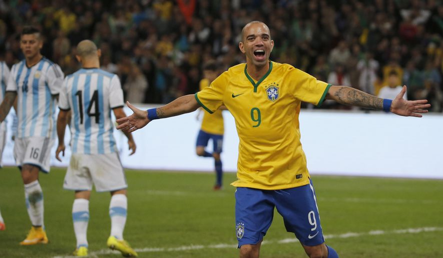 Brazil's Diego Tardelli celebrates after he scored his team's second goal during a Brazil vs. Argentina friendly match at the Bird's Nest National Stadium in Beijing, China, Saturday, Oct. 11, 2014. (AP Photo/Ng Han Guan)