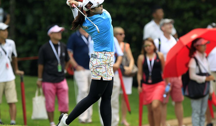 Pornanong Phatlum of Thailand hits a shot on the 18th hole during the third round of the LPGA Malaysia golf tournament at Kuala Lumpur Golf and Country Club in Kuala Lumpur, Malaysia, Saturday, Oct. 11, 2014. (AP Photo/Lai Seng Sin)